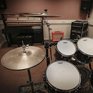 Live Room; Yamaha U3 piano, amp, Spirit Powerstation 600 PA System, Pearl Masters 5 piece drumkit