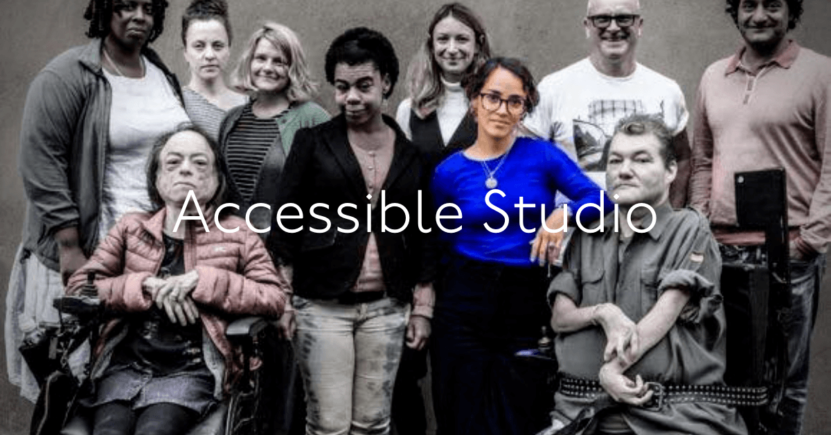 Group of people from different backgrounds and situations posing for photo at rear of studio